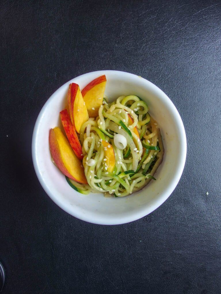 Zucchini and Cucumber Noodle Salad with Peanut Sauce and Fresh Peaches - Yup, it's Vegan