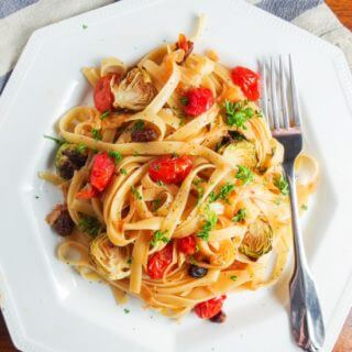 Caramelized Onion Fettuccine with Smoked Cherry Tomatoes and Pickled Raisins