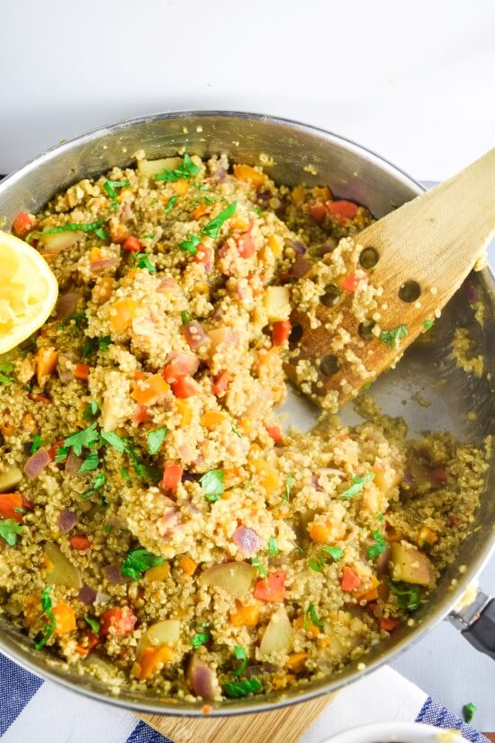One Pot Moroccan Quinoa with Red Lentils | yupitsvegan.com. Hearty quinoa dish that all cooks in one pan, packed with veggies, flavored with warming Moroccan spices, and finished with herbs, toasted almonds, and a splash of fresh citrus.
