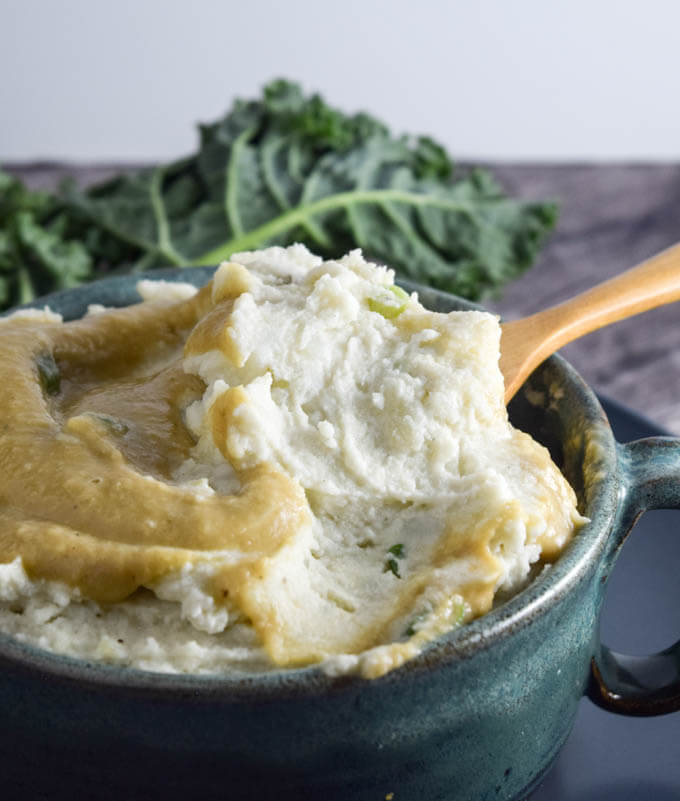 3-Ingredient Ultra Creamy Vegan Roasted Garlic Mashed Potatoes with White Bean Gravy | yupitsvegan.com. Healthy and delicious garlicky vegan mashed potatoes with no added oil or butter!