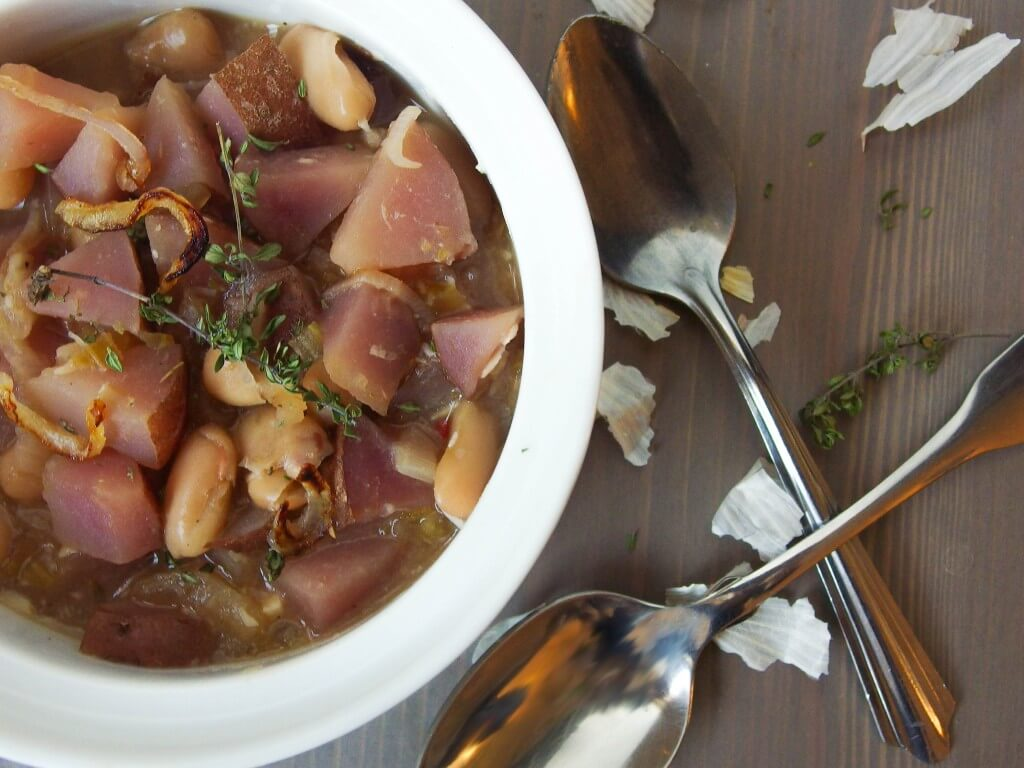 White bean stew with caramelized shallot, roasted garlic and purple potato - Yup, it's Vegan