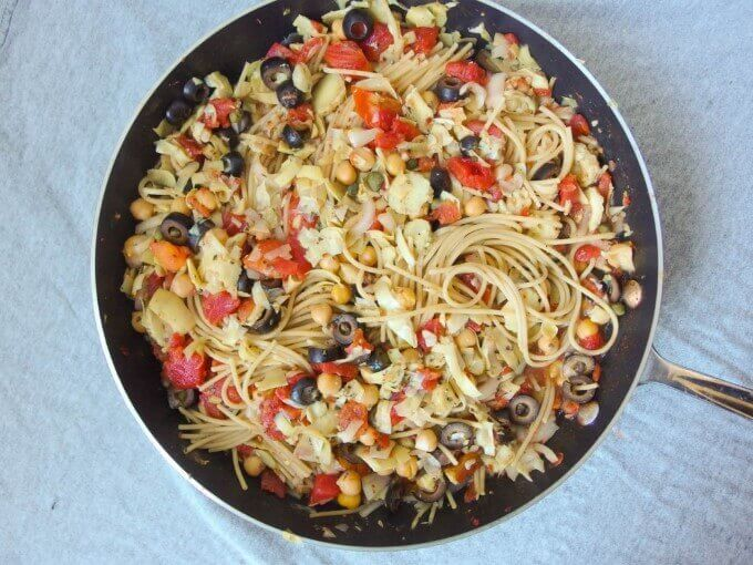 One Pot Spaghetti Alla Puttanesca after cooking. Easy one pan vegan spaghetti puttanesca made with whole wheat spaghetti, artichoke hearts and chickpeas for protein.
