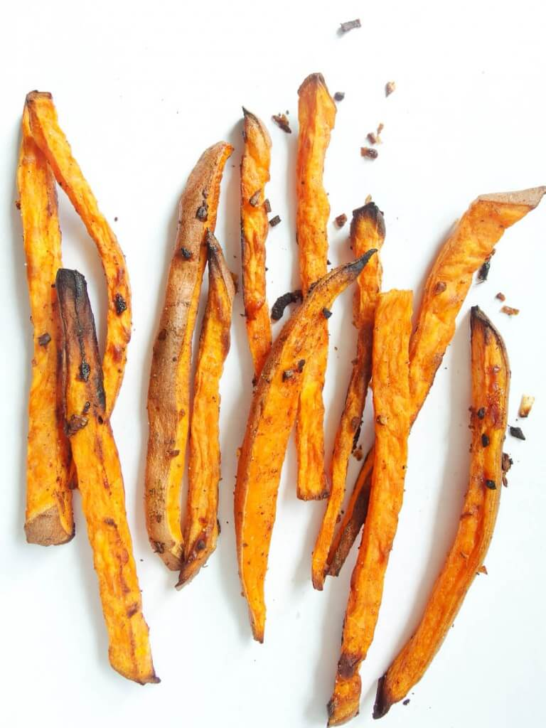 Beer-marinated Baked Sweet Potato Fries garnished with pepper blackened tips crispy and soft