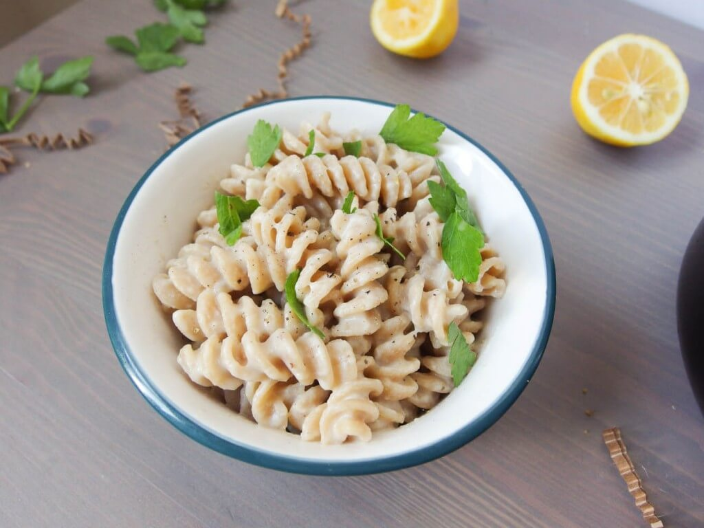 Creamy Roasted Garlic Meyer Lemon Rotini Pasta garnished with black pepper and cilantro
