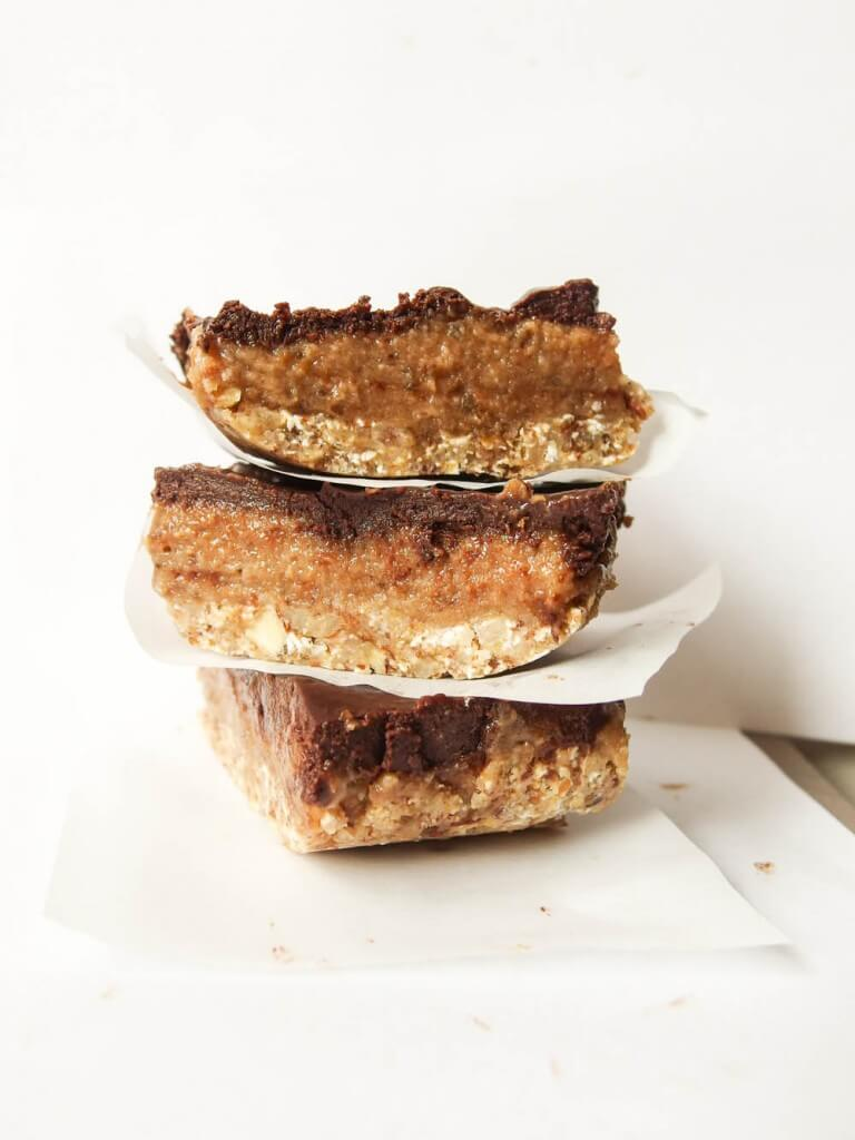 Simple Vegan Date Caramel Mocha Bars with crunchy almond oat crust stacked three high