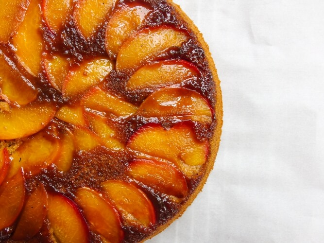Closeup of gooey caramelized summer fruit nectarine cake with low glycemic index coconut sugar