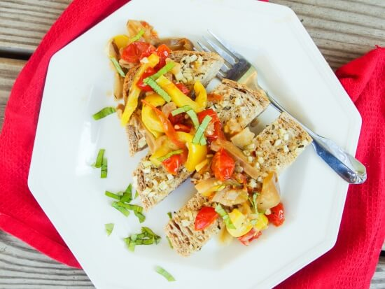 Zucchini, yellow bell pepper, cherry tomatoes with juice, eggplant, and fresh basil slices garnished with garlic chunks served on garlic bread slices - makes a great main dish or side or appetizer