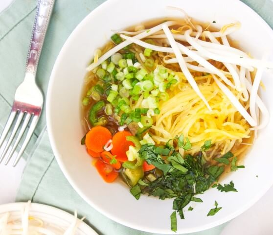 Vegan, gluten, oil, nut, and refined sugar free pho with spaghetti squash noodles, scallions, carrots, bean sprouts, cilantro, and fresh thai basil | yupitsvegan.com