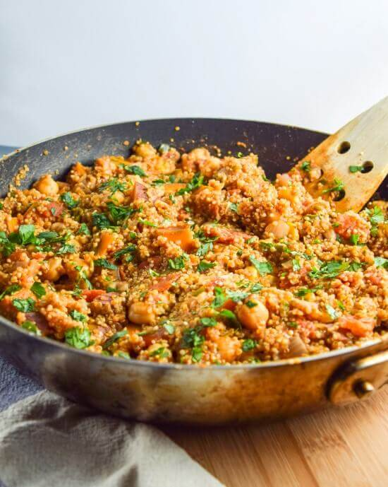 A flavorful authentic tandoori spice blend with grains, vegetables, and beans pair with vegetables to make a flavorful and satisfying meal all prepared in one skillet