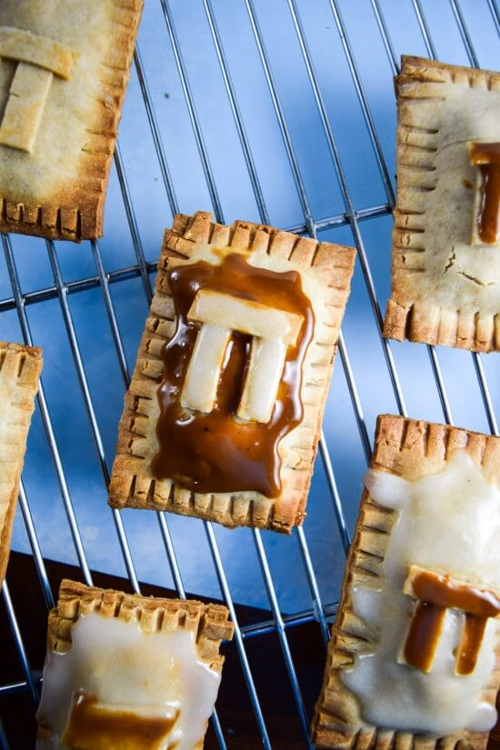 Vegan pecan pie pastries for Pi Day, or skip the extra design work and just make regular pop tarts! Filled with toasted crunchy pecans, creamy rich date caramel, and sweet icing