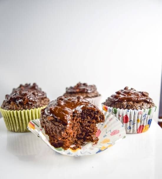 Easy, moist, and fudgy chocolate cupcakes with avocado replacing oil, whole grain spelt flour, rich intense coffee, and fluffy baking soda for rise