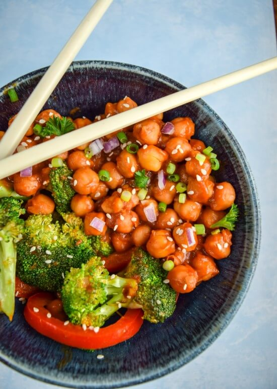 A healthy spin on a classic asian dish. Coconut sugar, chili hot sauce, peanut butter, and tomato paste come together to make a from scratch general tso's sauce coating healthy stir fried chickpeas and fresh vegetables.