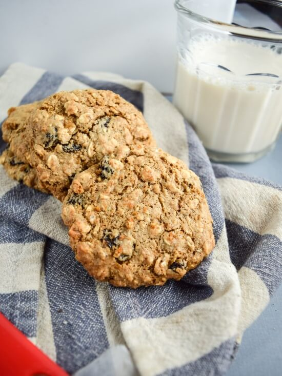 Chewy Vegan Oatmeal Raisin Cookies with a nice cold glass of almond milk!