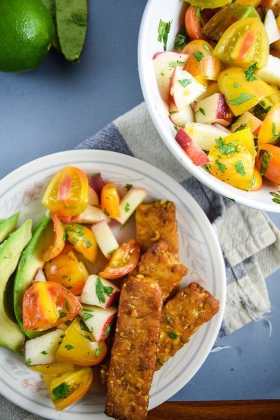 Smoky Tempeh with Fresh Peach and Cherry Tomato Salsa | yupitsvegan.com. Easy vegan baked tempeh with just a few minutes of prep needed, paired with a bright and fresh late-summer salsa. Vegan, gluten-free, grain-free meal.
