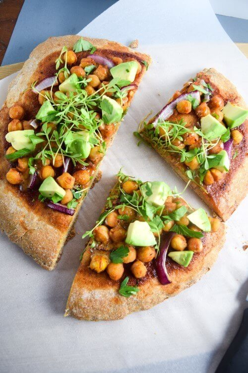 BBQ Chickpea Pizza | yupitsvegan.com. Crispy and fluffy pizza crust smothered with BBQ sauce and topped with chickpeas, red onions, avocados, and fresh herbs.