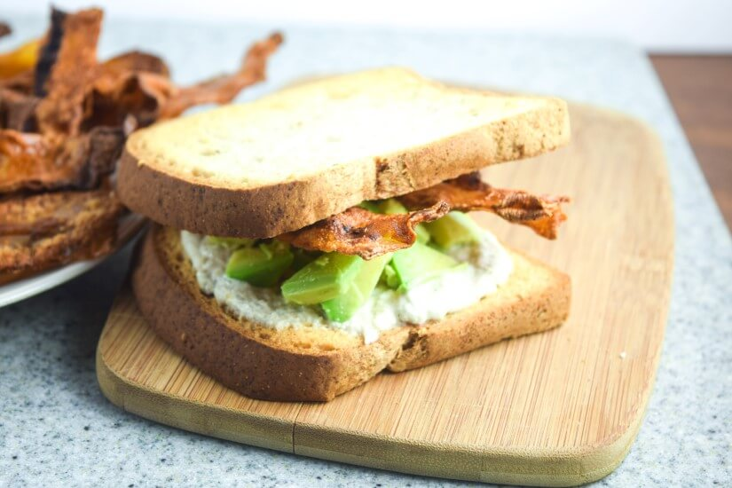Vegan and glutenfree soy mayo, avocado chunk, and crispy rice paper bacon sandwich