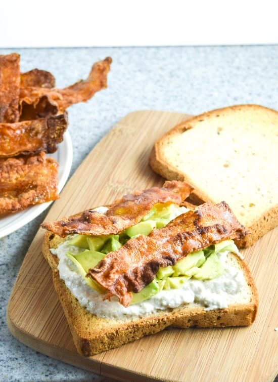 Openface sandwich made on gluten free bread with from scratch simply rice paper bacon, paired with rich avocado, and creamy mayo for the perfect lunch