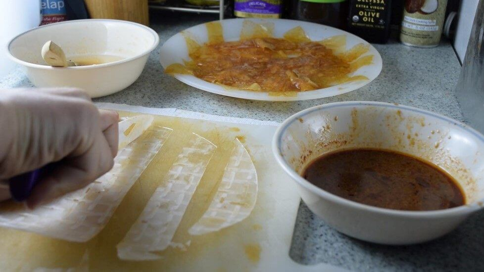 Step-by-step photos for making vegan bacon out of rice paper! Cut the rice paper into strips with marinades prepared