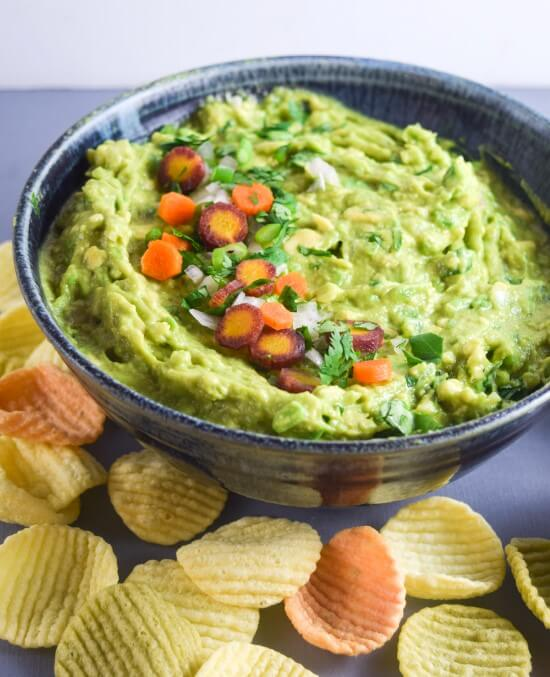 Thai Green Curry Guacamole: Asian-fusion guacamole is a match made in heaven! Mashed avocado seasoned with Thai curry paste, coriander, fresh lime, shallot, and pickled carrots.