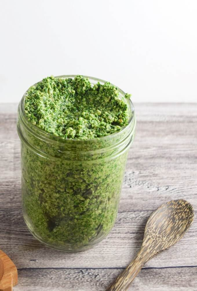 Creamy vegan pesto made with nutrient dense curly kale, garlic scapes paired with bright lemon, and hearty walnuts