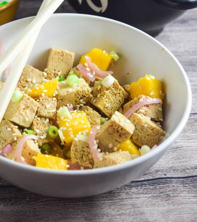 Tofu Poke with Mango and Pickled Shallot | Yup, it's Vegan. Hawaiian-inspired cold marinated tofu, bursting with flavor from sesame, scallions, and chili sauce. Light vegan, gluten-free summer meal that comes together with only a few minutes of hands-on time.