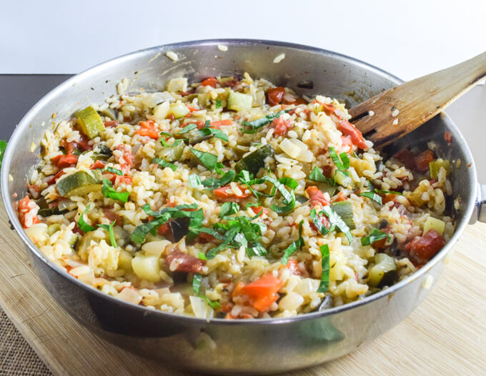 A simple, gluten, nut, and soy free vegan one pot ratatouille rice meal highlighting summer vegetables