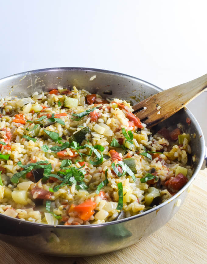 Fluffy white vegan rice cooked with fresh eggplant, juicy tomatoes, crunchy red bell pepper, and rich summer squash for the perfect easy meal | Yup, it's Vegan