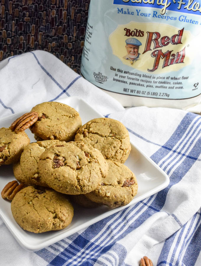 Warm cinnamon and crunchy candied maple pecans come together with gluten free flour and oats to make a perfect allergy friendly cookie