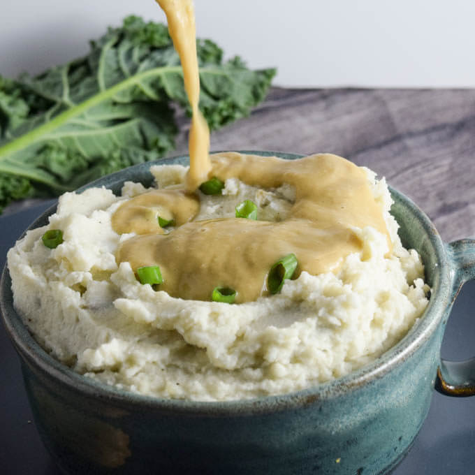 3-Ingredient Super Creamy Vegan Roasted Garlic Mashed Potatoes with White Bean Gravy | yupitsvegan.com