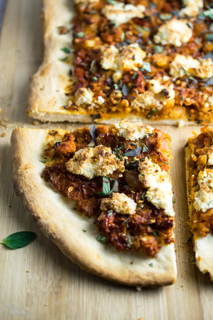 Sicilian Cauliflower Pizza - spicy and saucy braised cauliflower and almond ricotta on crispy flatbread with oregano garnish | Yup, it's Vegan