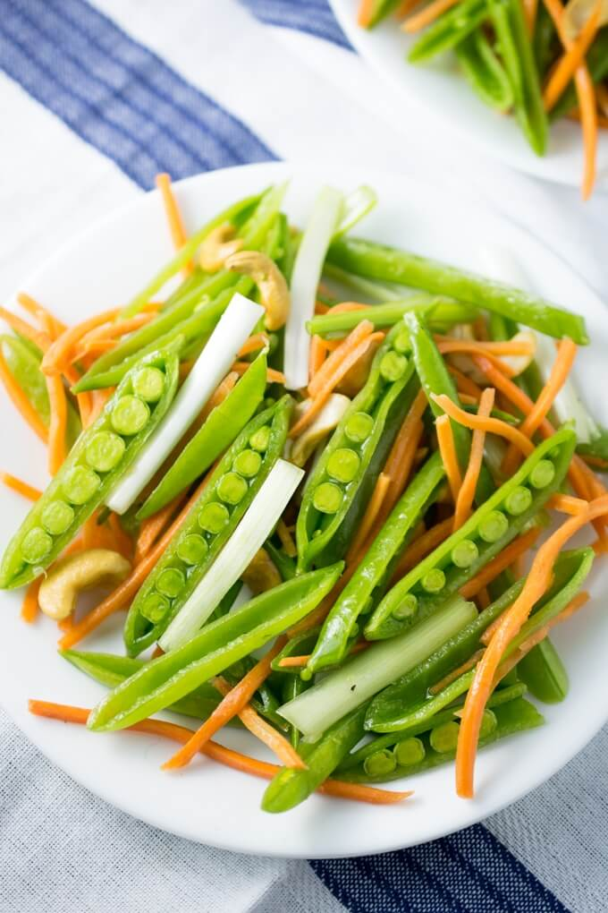 Cashew Sesame Snap Pea Salad | Yup, it's Vegan. Fresh sugar snap peas, carrots, cashews and scallions with citrus sesame dressing.