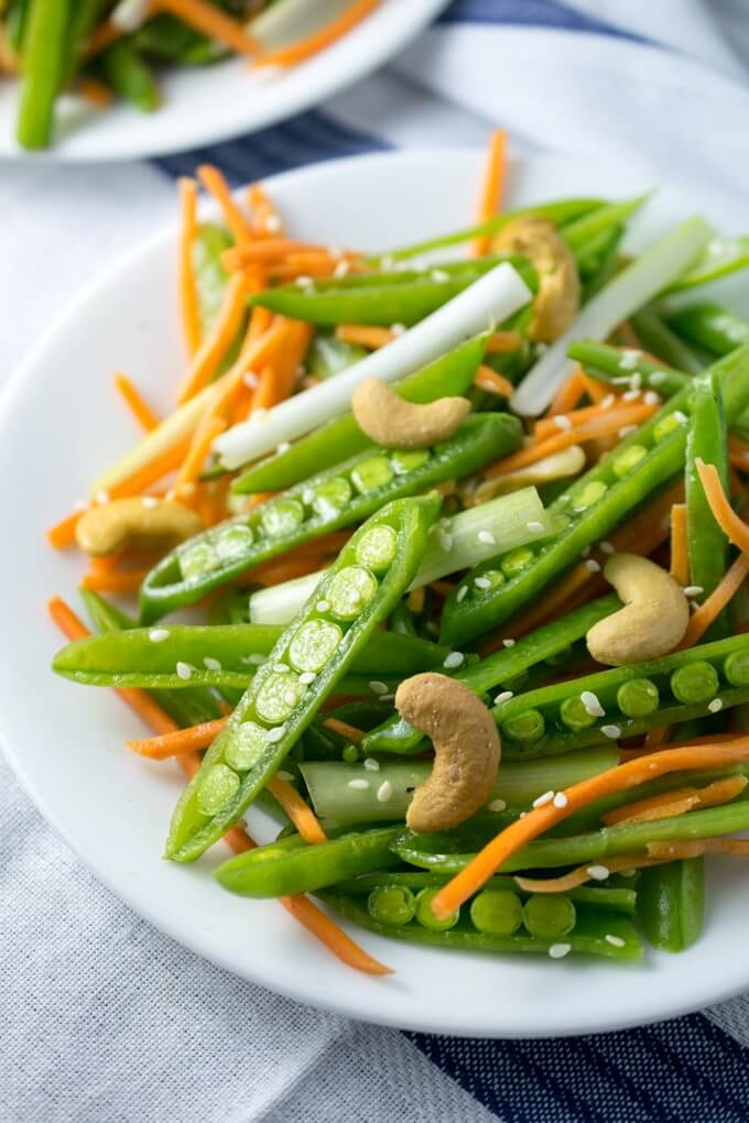 Cashew Sesame Snap Pea Salad | Yup, it's Vegan. Just 15 minutes and 7 ingredients stand between you and this vibrant spring salad! Vegan, gluten-free, and packed with veggies.