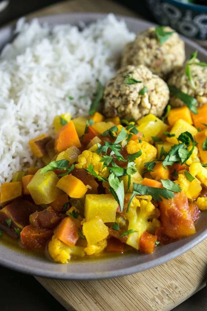 Glowing Moroccan Vegetable Stew | Yup, it's Vegan. Bright and lemony turnip, cauliflower, sweet potato and carrot stew with Moroccan spices and fresh cilantro.