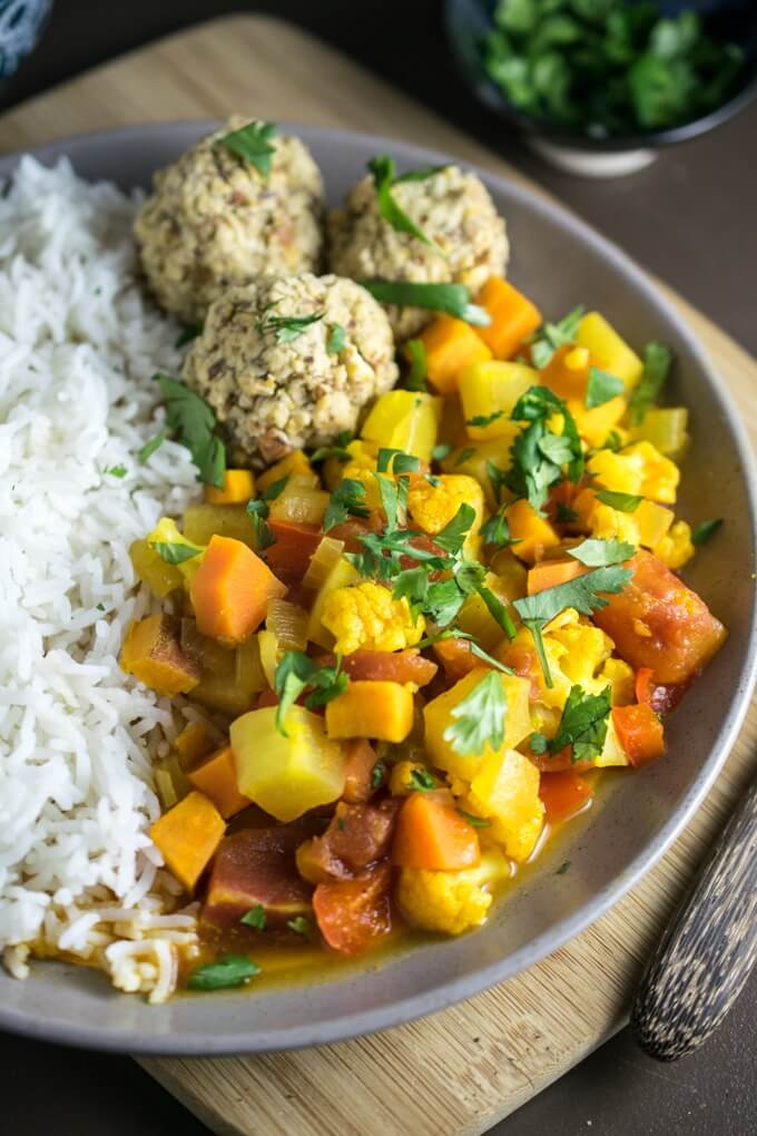 Glowing Moroccan Vegetable Stew | Yup, it's Vegan. Carrots, cauliflower, turnips, and sweet potato are braised in a Moroccan spiced broth.