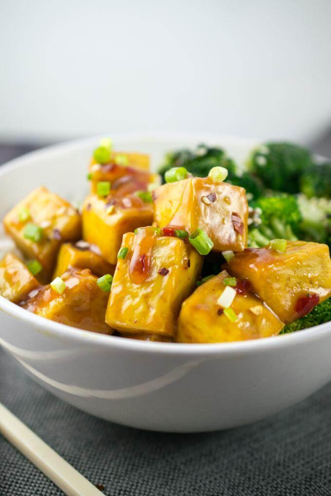 Baked tofu cubes tossed in an orange glaze, garnished with scallions and sweet chili sauce