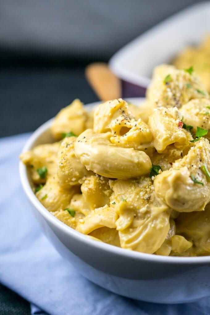 Closeup of pasta coated in a creamy vegan cauliflower sauce