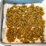 Vegan Baklava | Spreading pistachio-walnut mixture onto filo dough