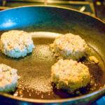 Vegan crab cakes frying in the pan