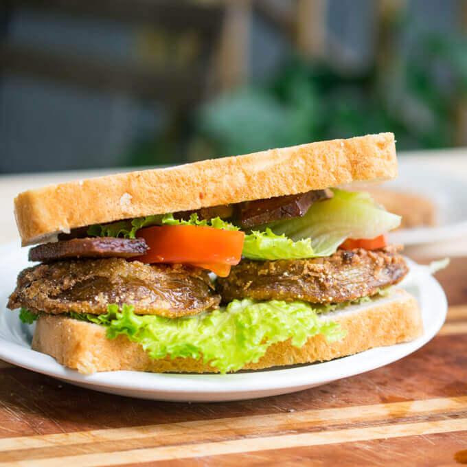 Assembled vegan fried green tomato BLT sandwich.