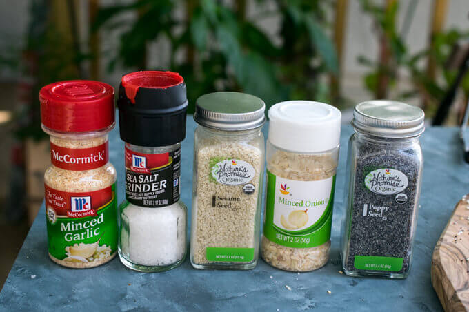The containers of spices to be used in everything bagel seasoning