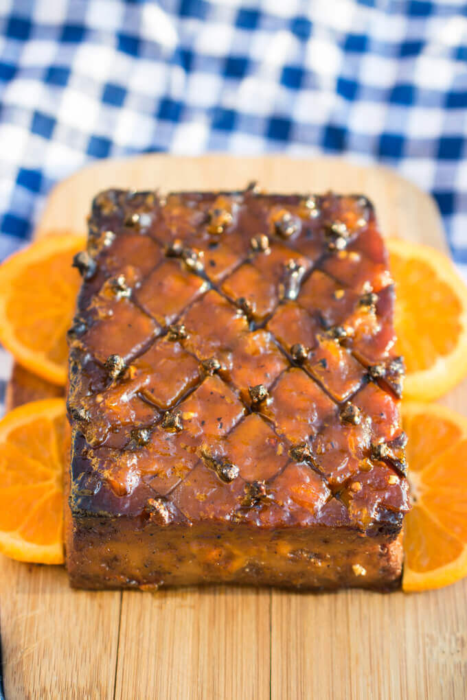 Vegan holiday glazed tofu roast on a bed of orange slices