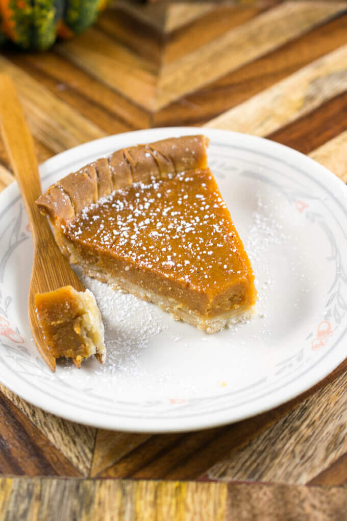 A bite of vegan sweet potato pie broken away from the rest of the slice