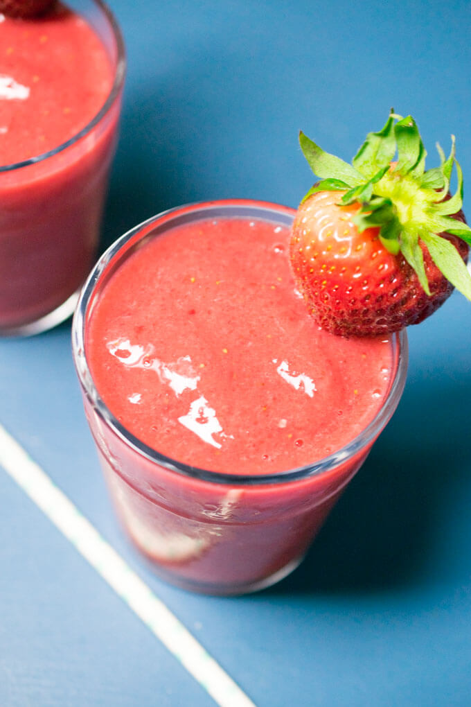 Close-up of a strawberry lemonade smoothie showing the creamy texture and vivid pink color
