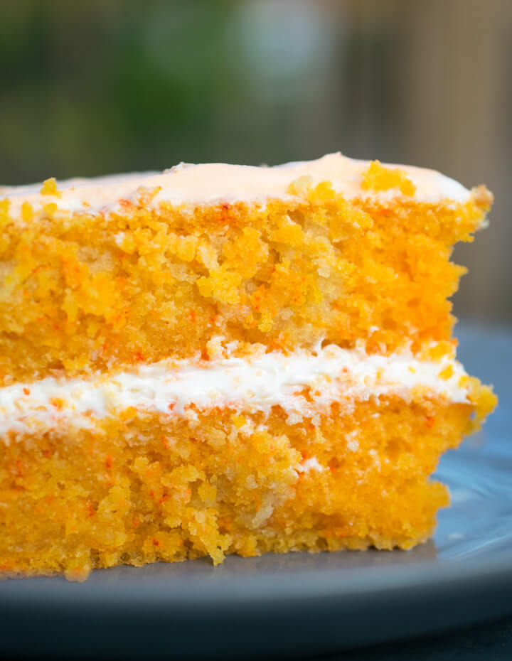 Close-up of the inside of a slice of vegan creamsicle cake, showing fluffy and moist texture.