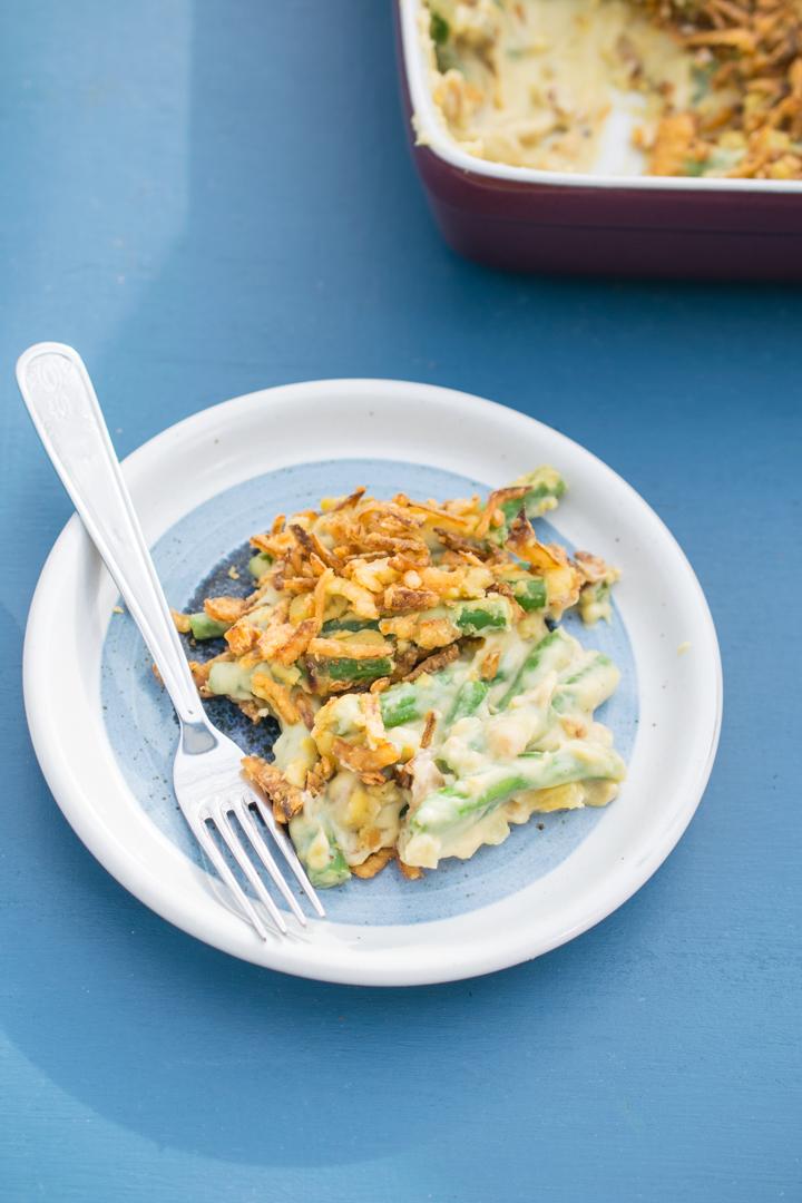 A serving of vegan green bean casserole on a ceramic plate